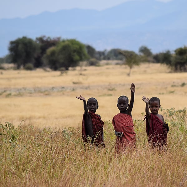 maasai boys waving