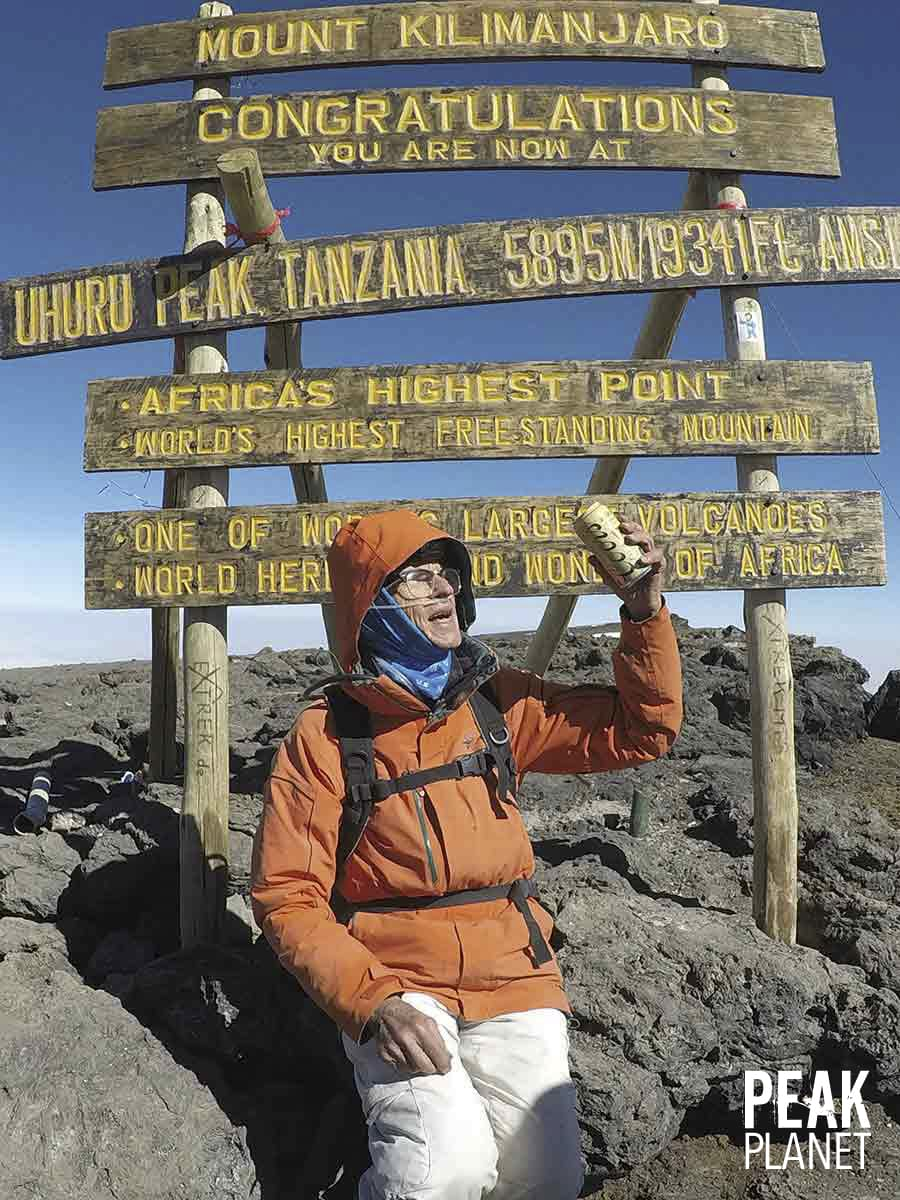 Dr Distelhorst drinking Coors Light on Kilimanjaro