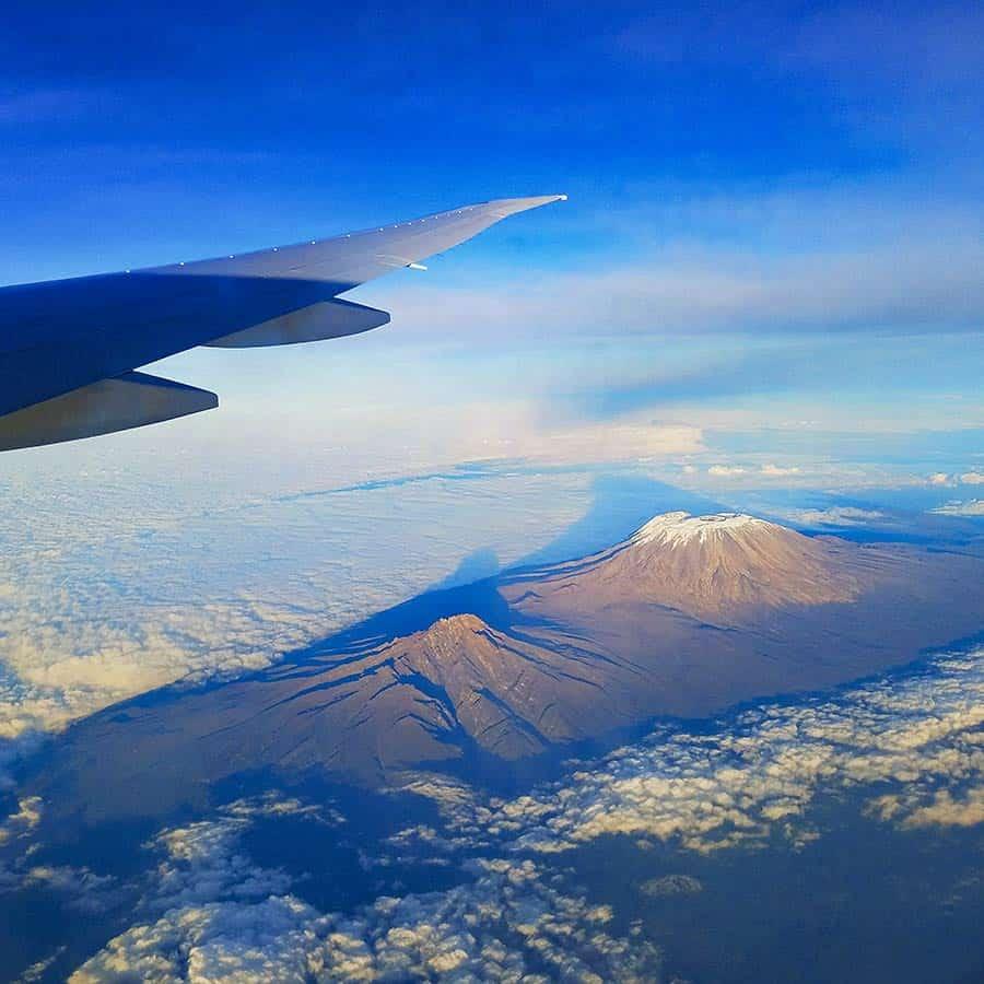 fly to climb Kilimanjaro