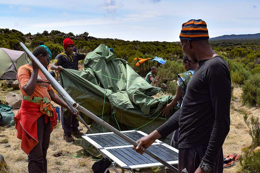 porters setting up tent