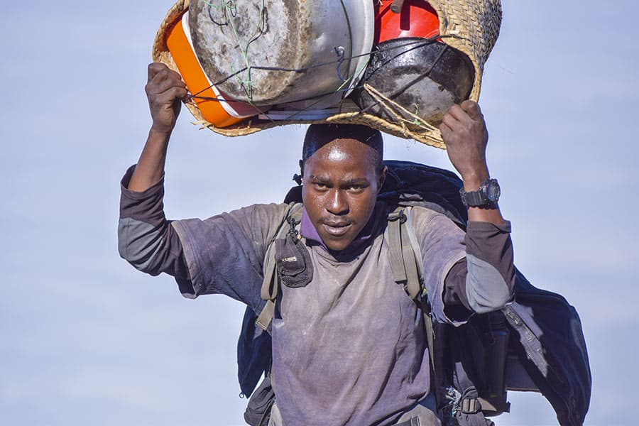porter carrying pots and pans