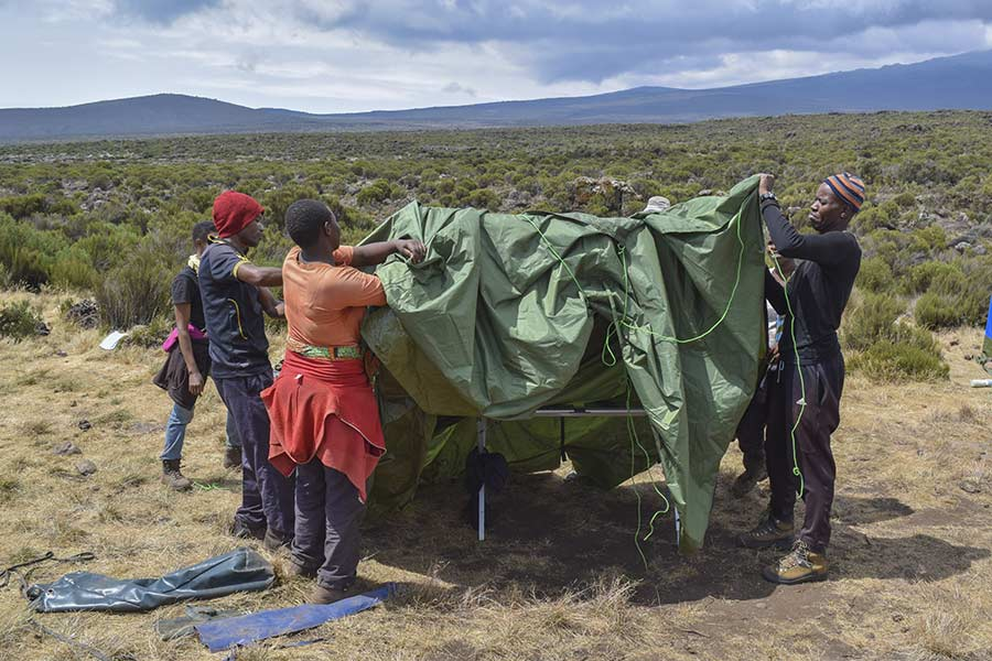 porters setting up a tent